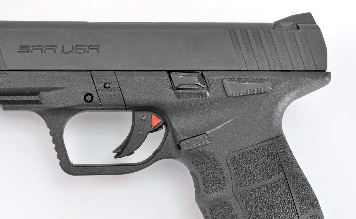 The SAR 9 features standard controls. What stands out are the triangular red cocking indicator and the significant undercut behind the trigger guard, which helps keep bore axis low.