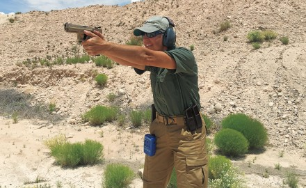 A proper stance has you leaning into the gun, body square to the target and arms straight.