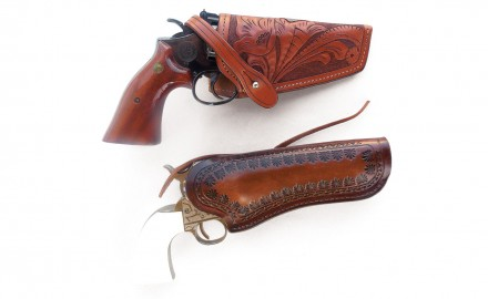 Holsters from Rocking K Saddlery (top) and Jeffrey Custom Leather are modern examples of the Threepersons design.