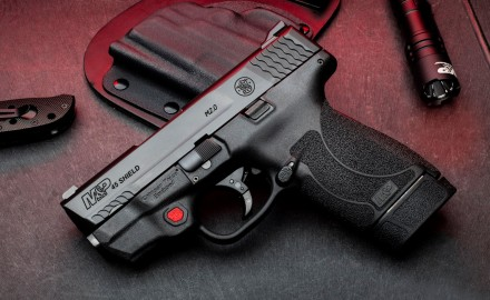M&P 45 Shield M2.0 pistol with integrated Crimson Trace red and green laser, chambered in .45 Auto.
