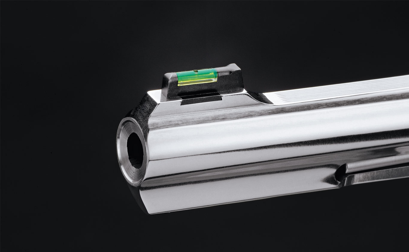 The front sight features a green fiber-optic rod, and the top rib is serrated to cut down on glare. A full-length underlug improves balance and recoil control.