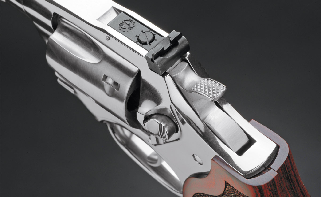 The Match Champion features an adjustable rear sight and a serrated hammer spur. The front of the cylinder has a slight taper for easy holstering.