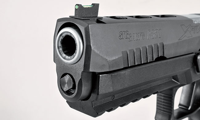 The front sight is a Dawson Precision fiber optic, and the slide-to-barrel fit is as tight as you'd find on a custom 1911—even though the X-Five is an assembly-line gun.