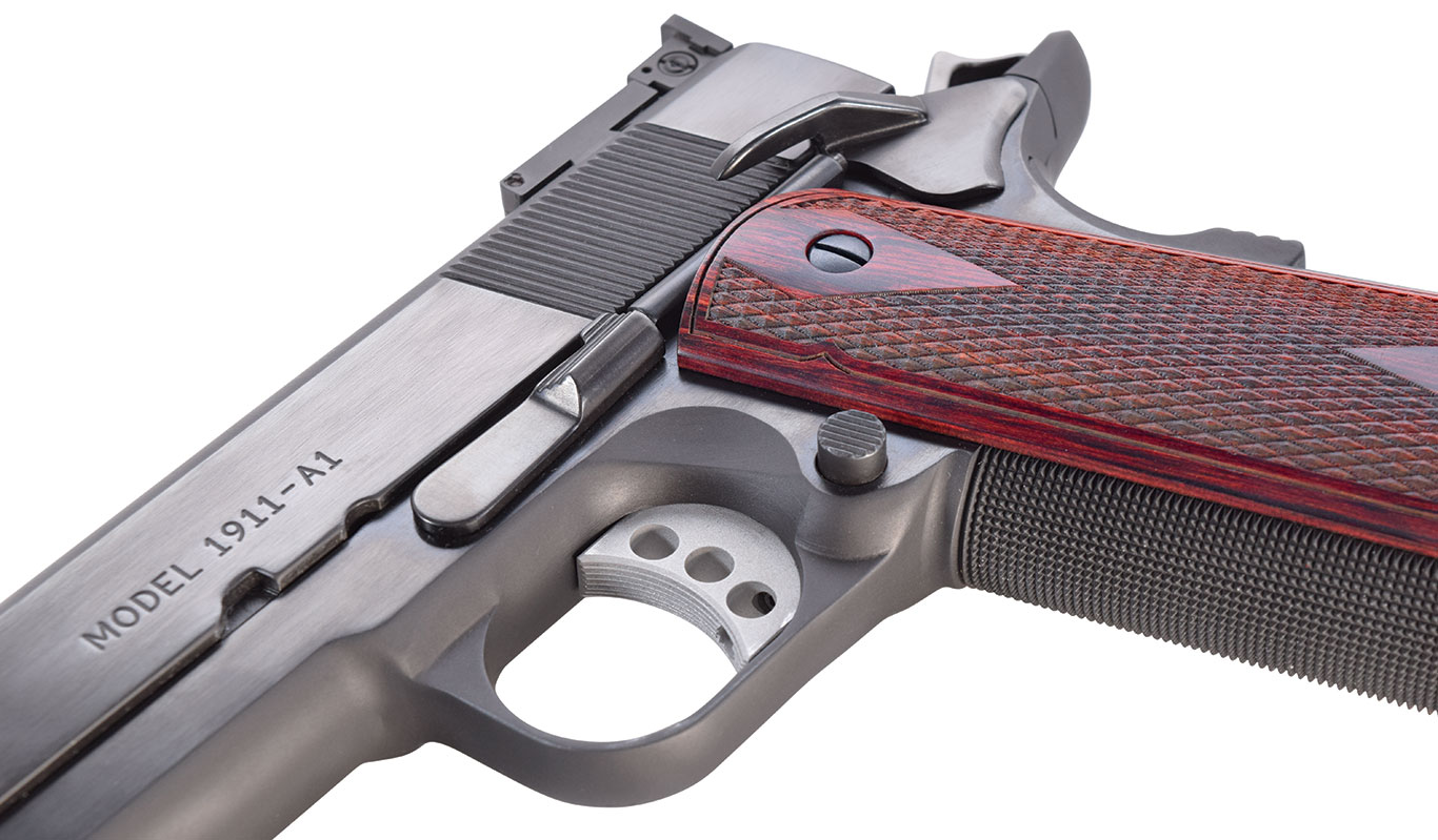 The magazine release is slightly extended, and the frontstrap and mainspring housing are checkered at 25 lpi. Grips are the classic double-diamond rosewood.