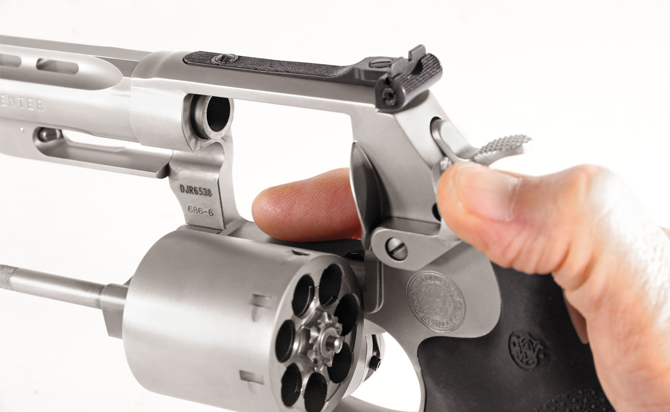 These large levers are designed to be opened with the thumb and the cylinder pushed out with the trigger finger.