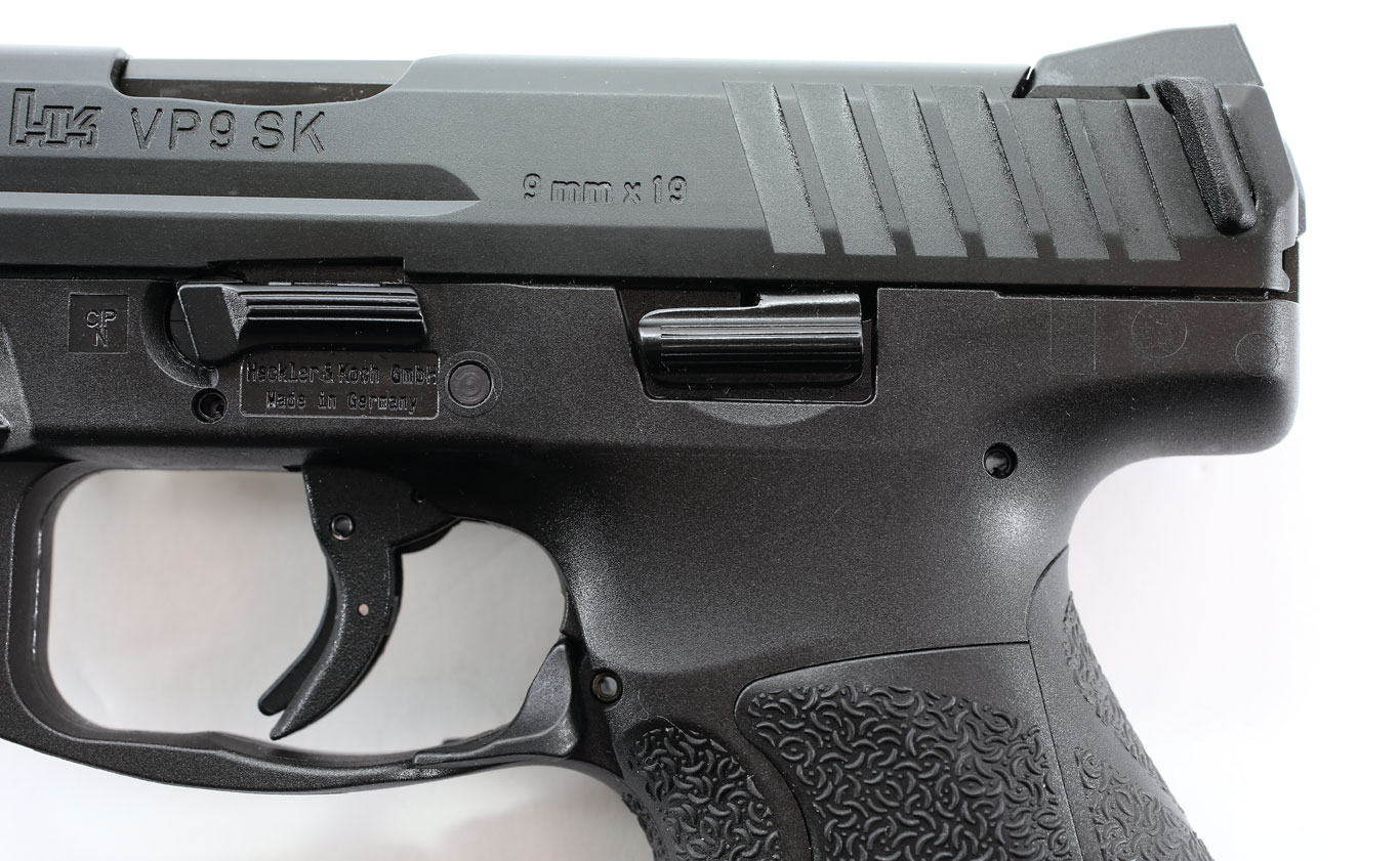 The pistol features an ambidextrous slide lock lever. The magazine release is an ambidextrous paddle at the bottom of the trigger guard. The trigger is crisp, with a short reset.