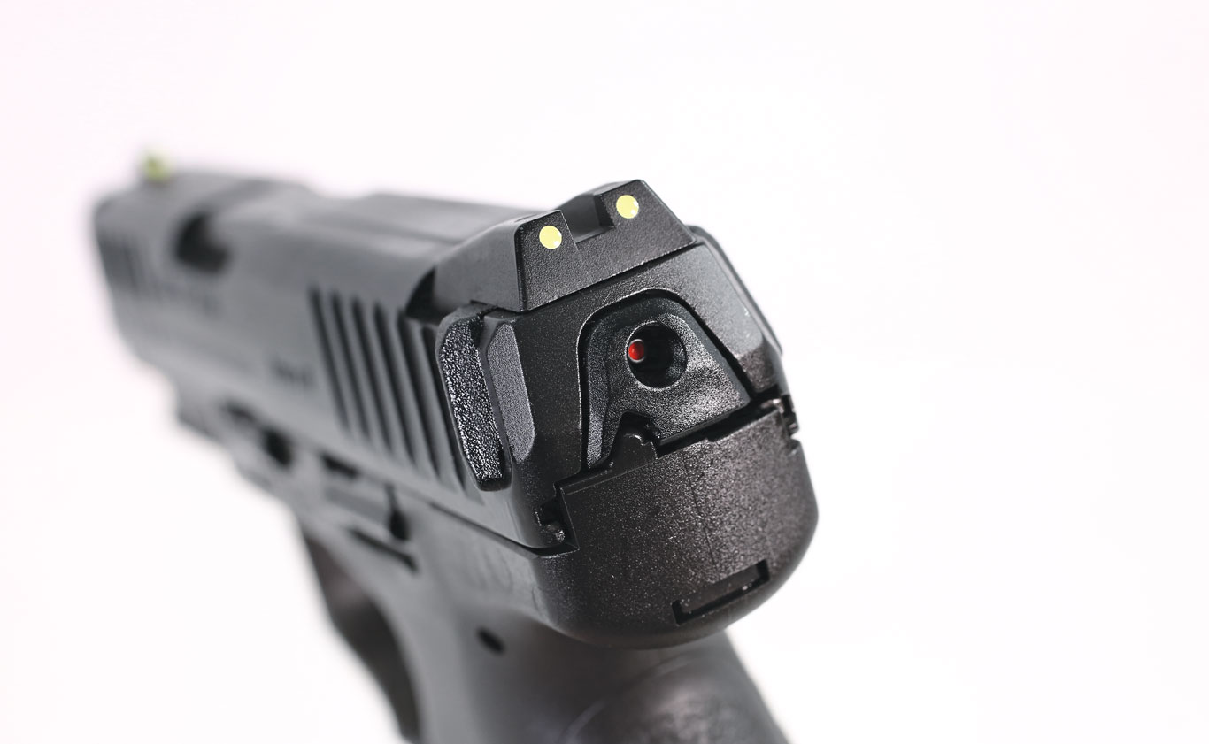 "The VP9SK is available with photoluminescent sights that can be quickly charged with a flashlight. The pistol also features HK's ""charging supports"" for easy slide manipulation."