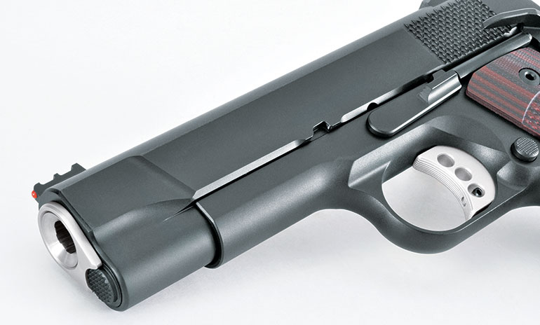"""The front of the gun features """"carry cuts"""" similar to those on the Browning Hi Power, which make holstering easier. The barrel has a significant crown for protection."""