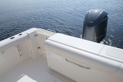 Transom door with stainless steel latch leads out to the e ladder. Max horsepower is 350 though 300 hp is standard. & Pursuit DC 265 - Florida Sportsman
