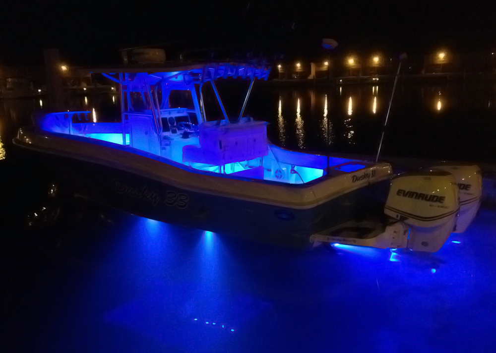 Lit up at night dockside this 33 is loaded with over for Night fishing lights for boats