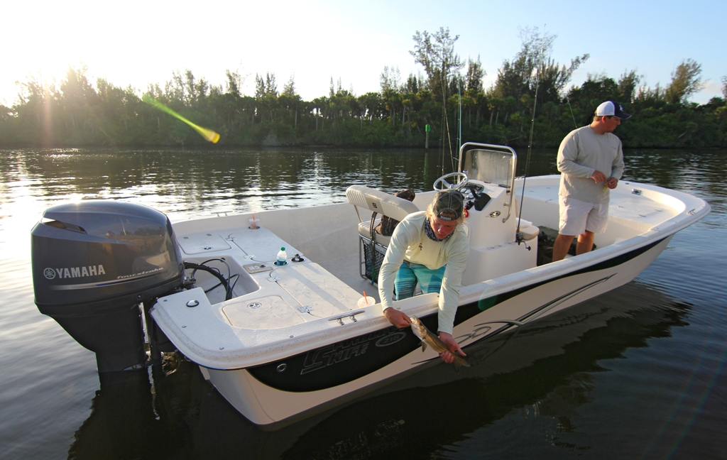 Carolina skiff dlv 218 florida sportsman scott sanders left and trey wheeler right release an underslot snook caught while pitching artificials in the st lucie river publicscrutiny Images