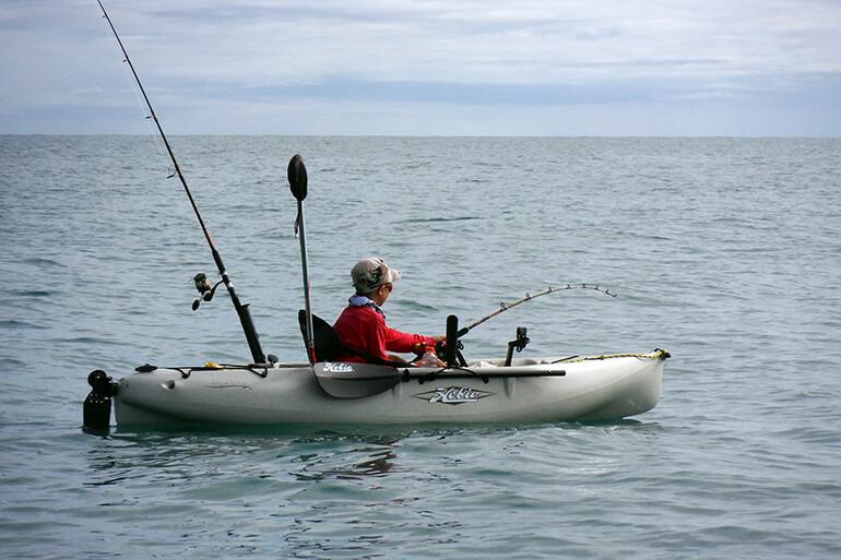 fighting kingfish from kayak